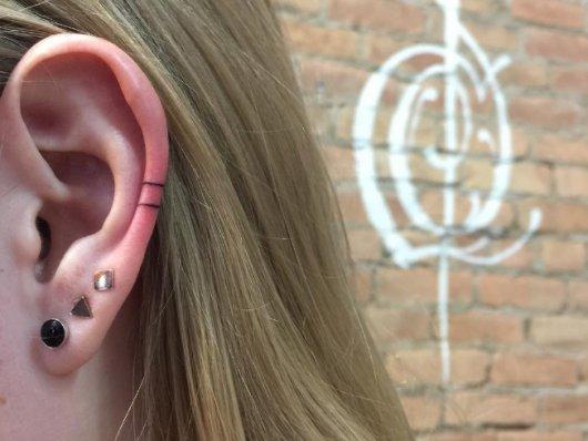 Татуировка на мочке уха 4